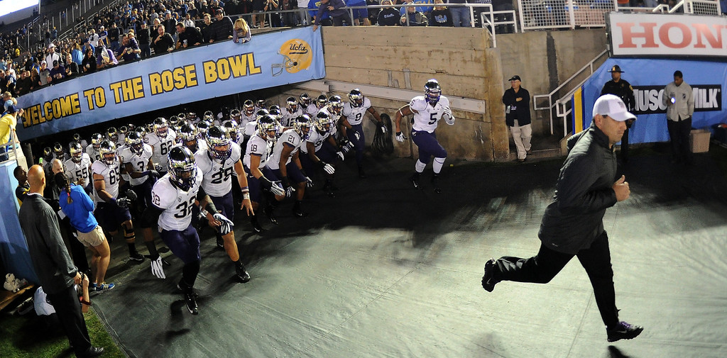 . Washington Huskies head coach Steve Sarkisian leads his team on to the field prior to their college football game against UCLA Bruins in the Rose Bowl in Pasadena, Calif., on Friday, Nov. 15, 2013.  UCLA won 41-31. 
