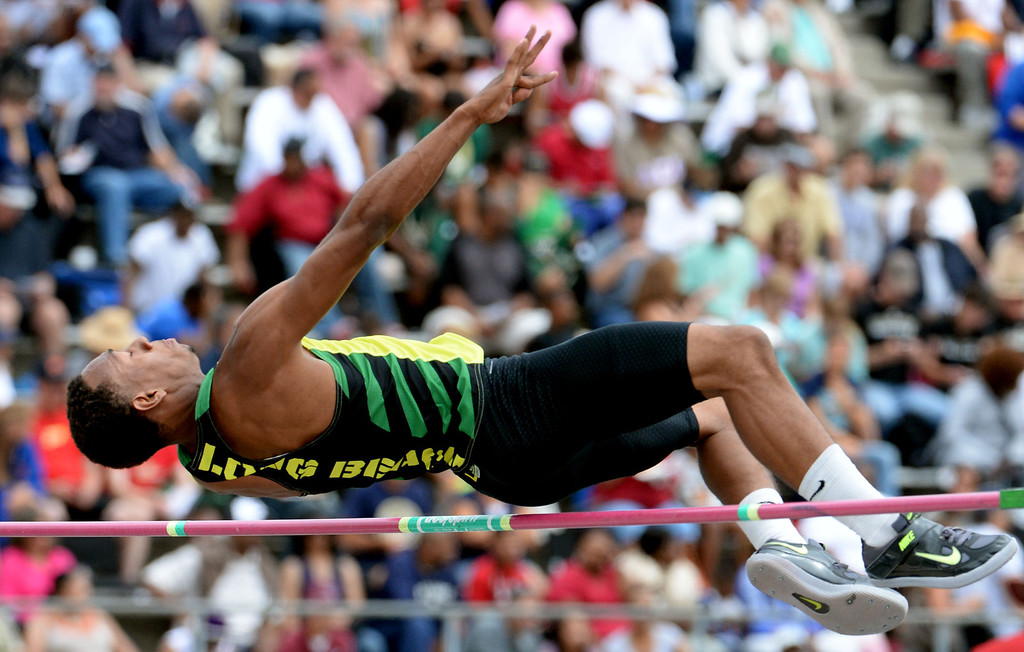 . Long Beach Poly\'s LaBrice Howard competes in the division 1 high jump during the CIF Southern Section track and final Championships at Cerritos College in Norwalk, Calif., Saturday, May 24, 2014. 