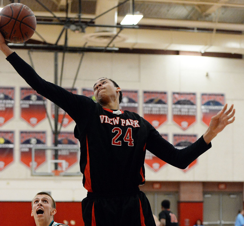 . View Park\'s Chance Comanche (C) rebounds over Renaissance Academy \'s Marty Gaizauskas in the first half of a CIF Southern California Regional Division basketball game at Colony High School in Ontario, Calif., on Saturday, March 22, 2014.  (Keith Birmingham Pasadena Star-News)