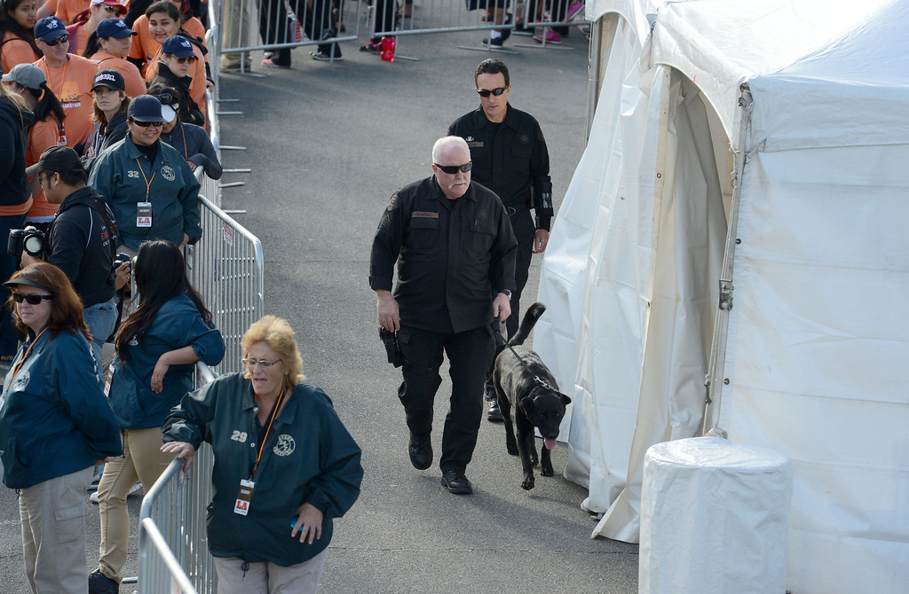 . Member of the LA County Sheriff bomb squad patrol the finish line of the 2014 ASICS LA Marathon in Santa Monica Calif,    Sunday, March 9,  2014. 