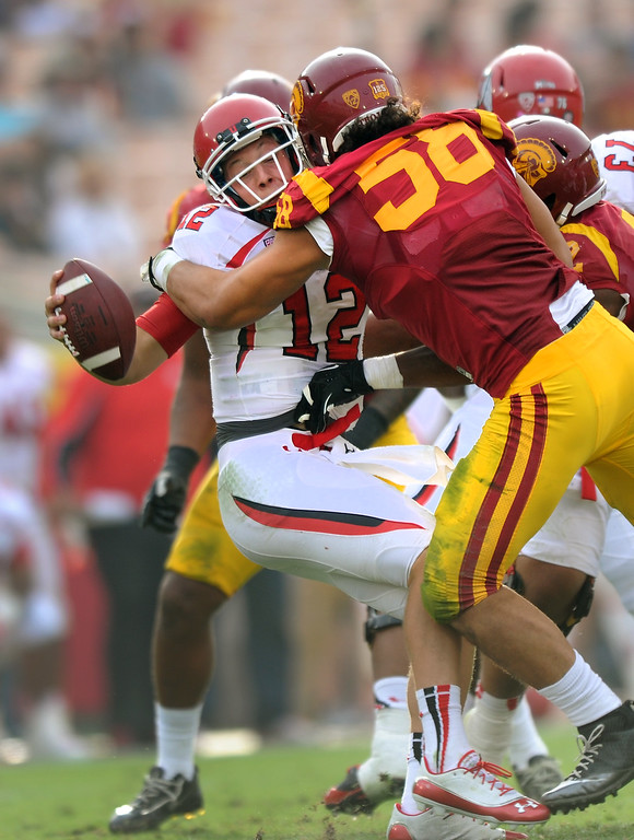 . USC\'s J.R. Tavai sacks Utah QB Adam Schulz in the fourth quarter, Saturday, October 26, 2013, at the L.A. Memorial Coliseum. (Michael Owen Baker/L.A. Daily News)