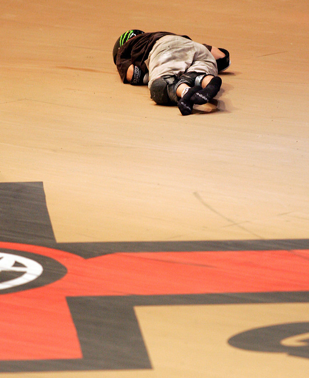 . Jake Brown lays motionless after falling some 50 feet after completing the very elusive 720 degree spin during X Games 13 at Staples Center in Los Angeles California on August 2, 2007.  He was able to walk away from this dramatic fall. (SGVN/Staff Photo by Raul Roa/Sports)