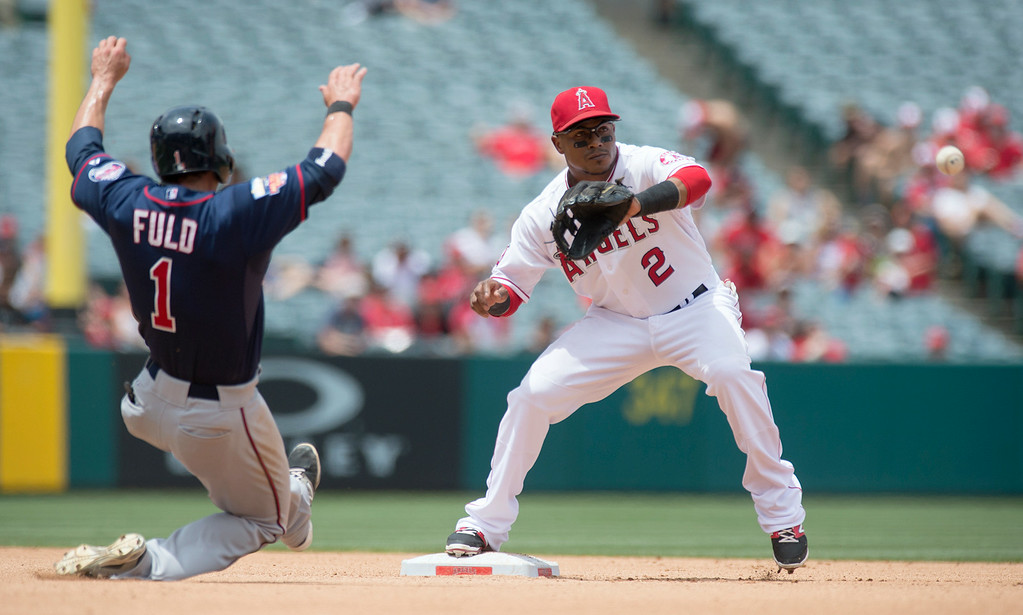 . Angels\' shortstop Erick Aybar (#2) forces out Minnesota Twins\' Sam Fuld (#1) at second base during their game at Angel Stadium in Anaheim on Thursday June 26, 2014. (Photo by Keith Durflinger/Whittier Daily News)