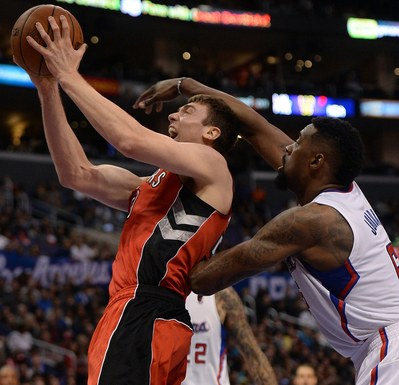 . The Raptors� Tyler Hansbrough #50 shoots as the Clippers� DeAndre Jordan #6 defends during their game at the Staples Center in Los Angeles Friday, February 7, 2014. (Photo by Hans Gutknecht/Los Angeles Daily News)