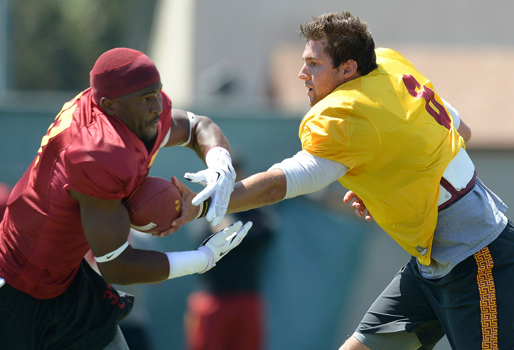 . QB Cody Kessler hands the ball off in practice. Football practice is in full swing on the Howard Jones Field at USC. Los Angeles, CA. 8/6/2014(Photo by John McCoy Daily News)