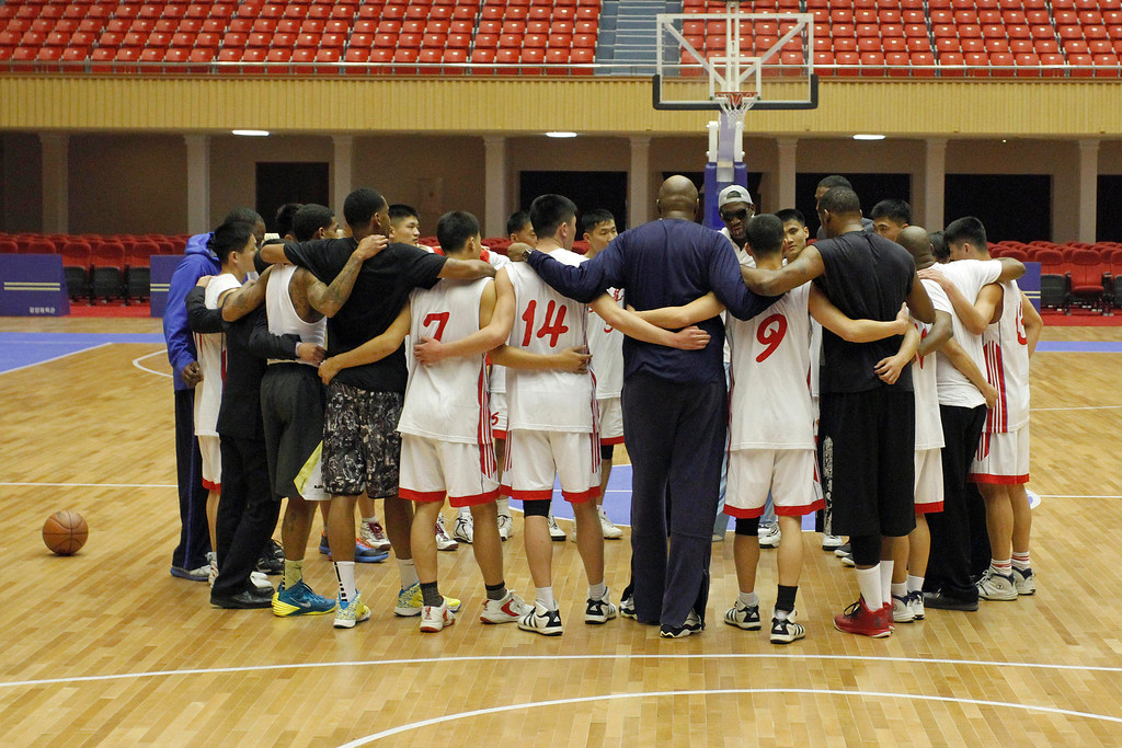. Dennis Rodman huddles with North Korean basketball players and fellow former NBA stars at a practice session in Pyongyang, North Korea on Tuesday, Jan. 7, 2014. Rodman came to the North Korean capital with a squad of U.S. basketball stars for an exhibition game on Jan. 8, the birthday of North Korean leader Kim Jong Un.  (AP Photo/Kim Kwang Hyon)