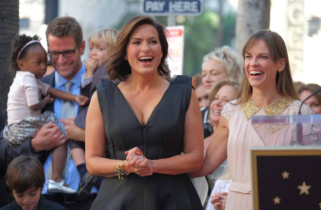 . Actresses Hillary Swank (R) and Mariska Hargitay laugh during a ceremony honoring Hargitay with a star on the Hollywood Walk of Fame on November 8, 2013 in Hollywood, California.   (JOE KLAMAR/AFP/Getty Images)