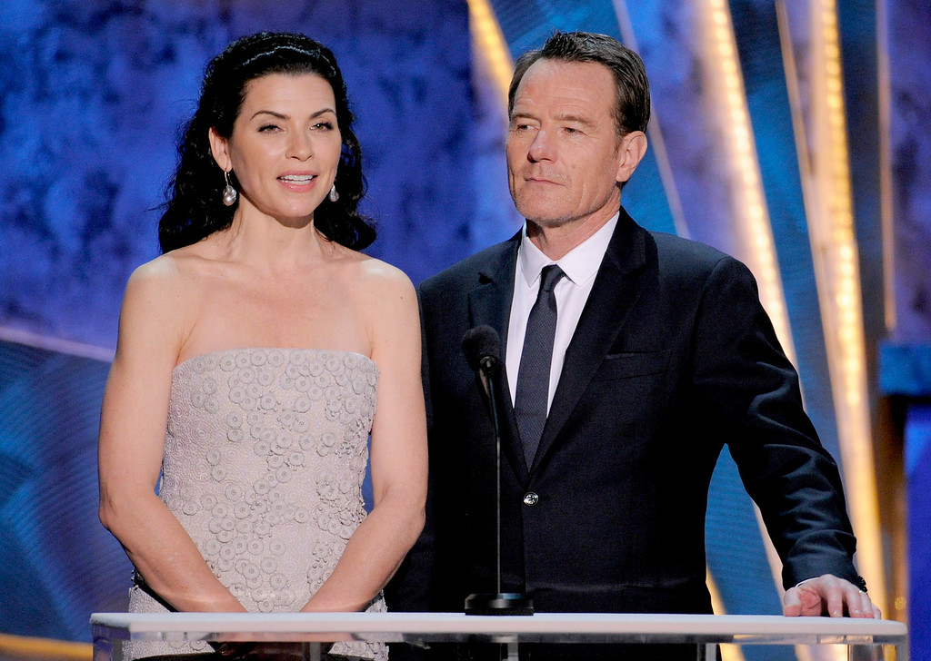 . Julianna Margulies and Bryan Cranston are seen onstage at the 18th Annual Screen Actors Guild Awards on Sunday Jan. 29, 2012 in Los Angeles. (AP Photo/Mark J. Terrill)