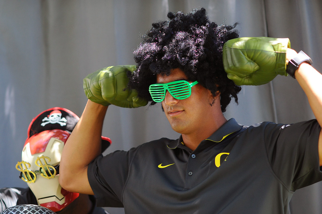 . Oregon quarterback Marcus Mariota poses for comical photos during PAC-12 Football Media Day at the Paramount Theater in Los Angeles, Ca July 23, 2014.(Andy Holzman/Los Angeles Daily News)