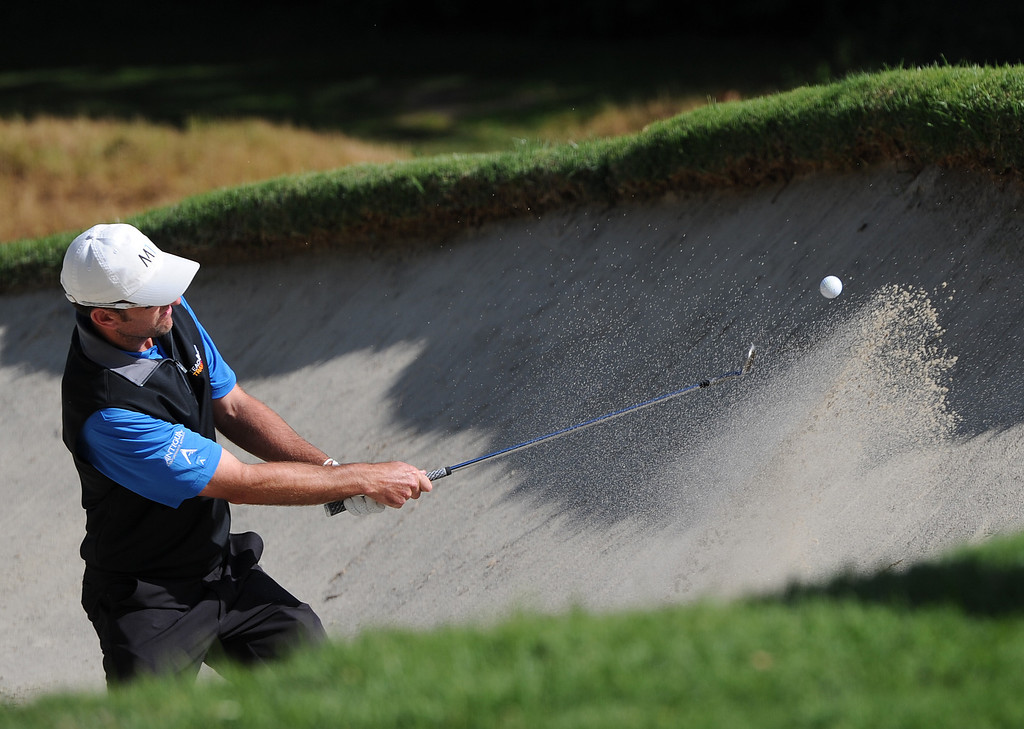. Jason Allred blasts out of the trap on 12. Bubba Watson would go on to win the 2014 Northern Trust Open. Pacific Palisades, CA. February 16, 2014 (Photo by John McCoy / Los Angeles Daily News)