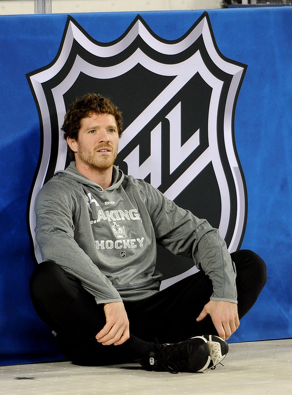 . Los Angeles Kings\' Colin Fraser stretches prior to the start of the inaugural NHL Stadium Series game against the Anaheim Ducks at Dodger Stadium in Los Angeles on Saturday, Jan. 25, 2014. (Keith Birmingham Pasadena Star-News)