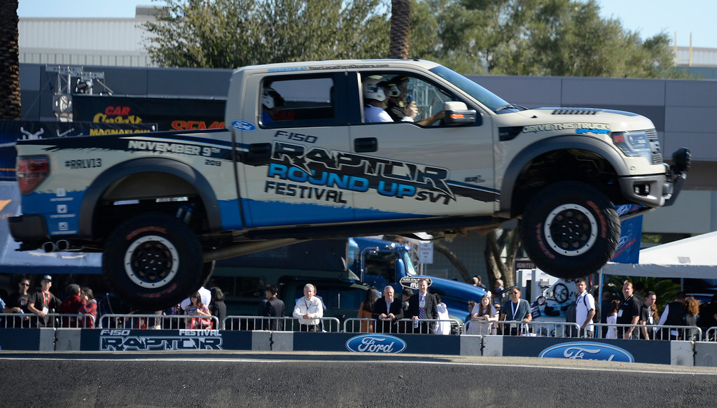 . Nov 5,2013 Las Vegas NV. USA. FORD gives free off road test drives in their new 2014 Raptor F-150 trucks during the first day of the 2013 SEMA auto show.