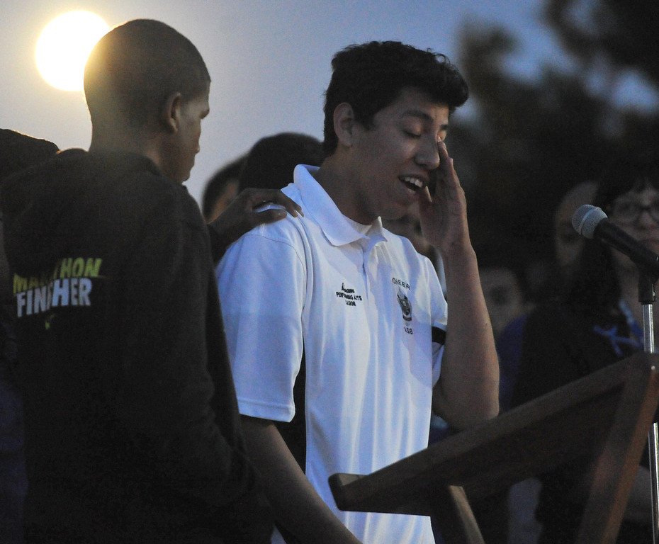 . Pioneer High School student, Abram Garcia, a student who was on the bus when it crashed, cries as he tells the story to family, students and members of the community gather in memory of Adrian Castro, 19, at El Monte High School Monday evening April 14, 2014. Castro was one of nine students killed in the bus crash in Orland, Calif. (Staff Photo by Keith Durflinger/San Gabriel Valley Tribune)