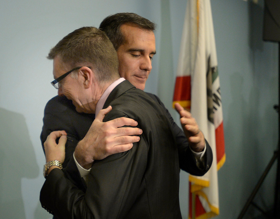 . LAUSD Superintendent John Deasy gets a hug from LA Mayor Eric Garcetti before  a news conference to provide an update on the bus crash in Northern California at the LAUSD headquarters. Los Angeles, CA. 4/11/2014 (Photo by John McCoy / Los Angeles Daily News)