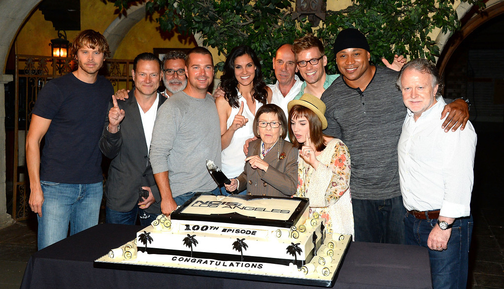 ". (L-R) Actors Eric Christian Olsen, Chris O\'Donnell, Miguel Ferrer, Daniela Ruah, Linda Hunt, Barrett Foa, L.L. Cool J, Renee Felice Smith and Shane Brennan attend the CBS\' ""NCIS: Los Angeles\"" celebrates the filming of their 100th episode held at Paramount Studios on August 23, 2013 in Hollywood, California.  (Photo by Mark Davis/Getty Images)"