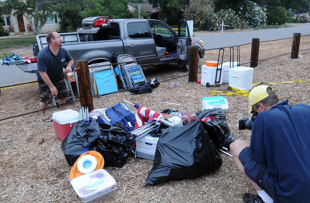 . 28 people have been injured due to malfunctioning fireworks at an annual 4th of July show in Simi Valley.  Twenty people were taken to hospitals late Thursday with minor to moderate injuries after the blast at the city-run Fireworks Extravaganza at Rancho Santa Susana Community Park.  Residents returned Friday morning to recover their belongings.  (Photo by Dean Musgrove/Los Angeles Daily News)