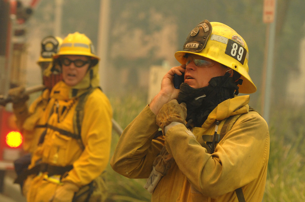 . LA County Fire personnel stage near housing at Cal State University Channel Islands. (Michael Owen Baker/Los Angeles Daily News)