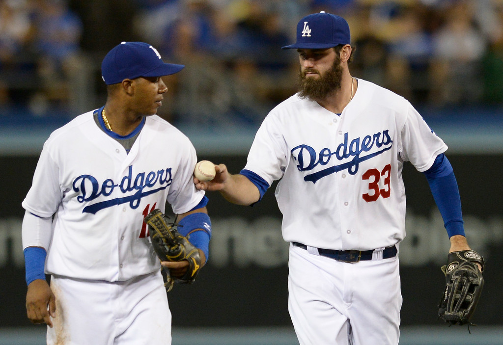 . Erisbel Arruebarrena is handed the ball by Scott Van Slyke at the end of the 8th. The Dodgers lost to the San Diego Padres 4-1 at Dodger Stadium. Los Angeles, CA. 8/20/2014(Photo by John McCoy Daily News)