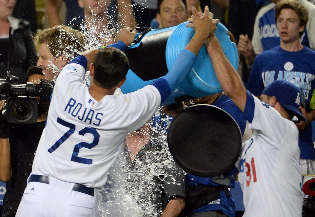 . Los Angeles Dodgers\' A.J. Ellis game winning sac fly ball as Adrian Gonzalez (not pictured) scores the winning run in the ninth inning as the Los Angeles Dodgers defeat the San Diego Padres 1-0 during a Major league baseball game on Saturday, July 12, 2014 in Los Angeles.   (Keith Birmingham/Pasadena Star-News)