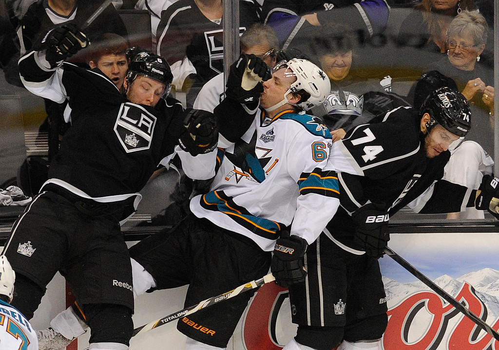 . Kings#6 Jake Muzzin and Kings#74 Dwight King slam Sharks#61 Justin Braun into the boards in the 2nd period. The Kings played the San Jose Sharks during the first game in the Second Round of the Western Conference Playoffs. Los Angeles CA 5/14/2013(John McCoy/LA Daily News)