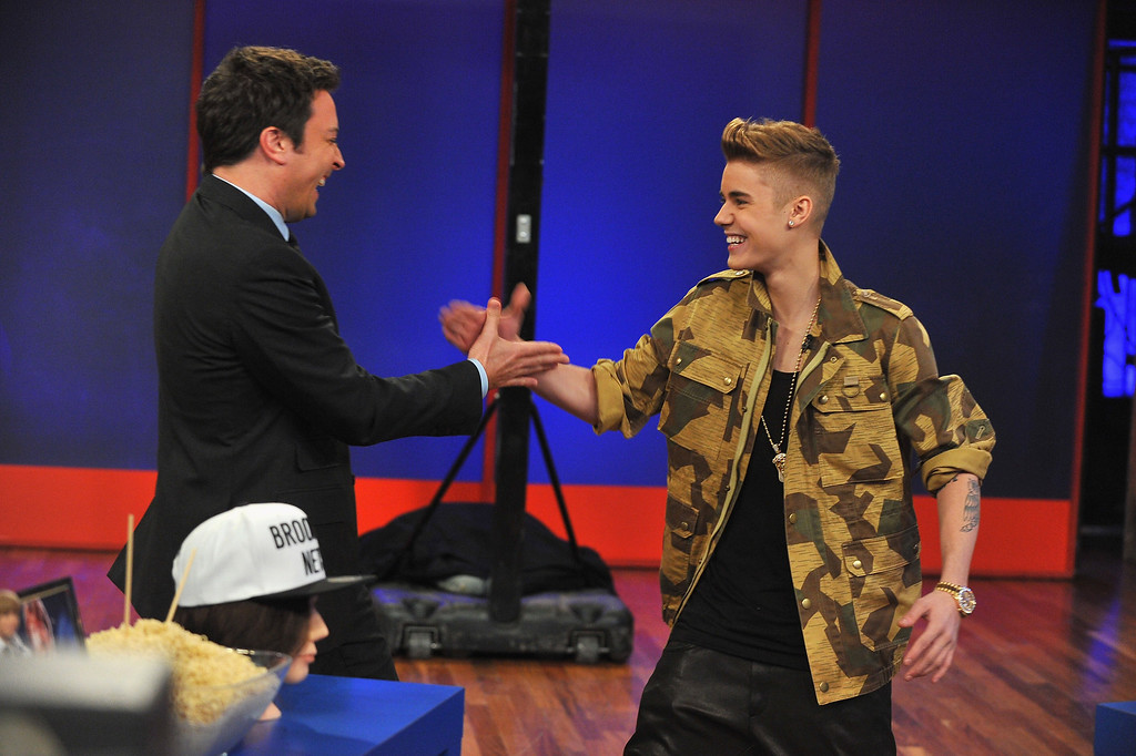 ". NEW YORK, NY - FEBRUARY 05:  Justin Bieber and Jimmy Fallon interaction during a taping of ""Late Night With Jimmy Fallon\"" at Rockefeller Center on February 5, 2013 in New York City.  (Photo by Theo Wargo/Getty Images)"
