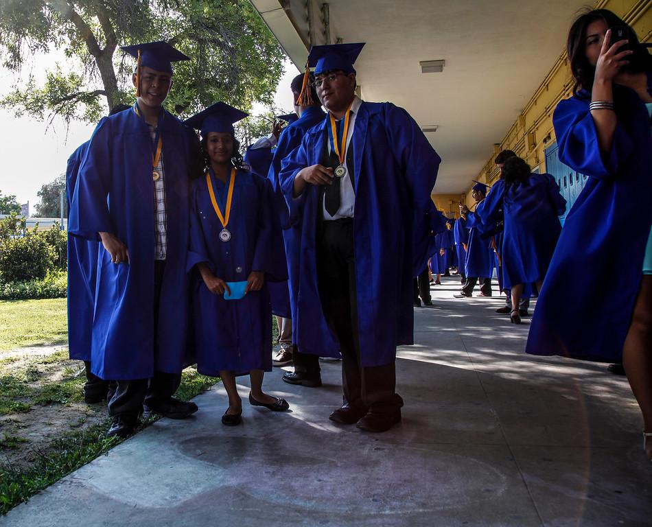 . Leroy Wallter and Danny Haiwongse meet Rebecca Natali Saavedra at their proper place for the graduation processional march, at John H Francis Polytechnic High School, Sun Valley, Calif., June 7, 2013. Photo: Lynn Levitt.