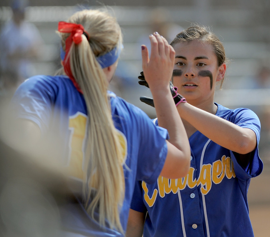 . 05-16-2013-( Daily Breeze Staff Photo by Sean Hiller) Wilson vs. El Toro in the opening round of the CIF-SS D2 playoffs Thursday at Joe Rodgers Field in Long Beach. Heather Nonora brings in a run for El Toro.