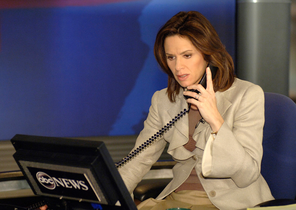 . In this photo released by ABC News, anchor person Elizabeth Vargas takes a phone call on the set of World News Tonight at ABC News headquarters in New York City, Tuesday, Jan 3, 2006 on her first official day as co-anchor. (AP Photo/ABC, Donna Svennevk)