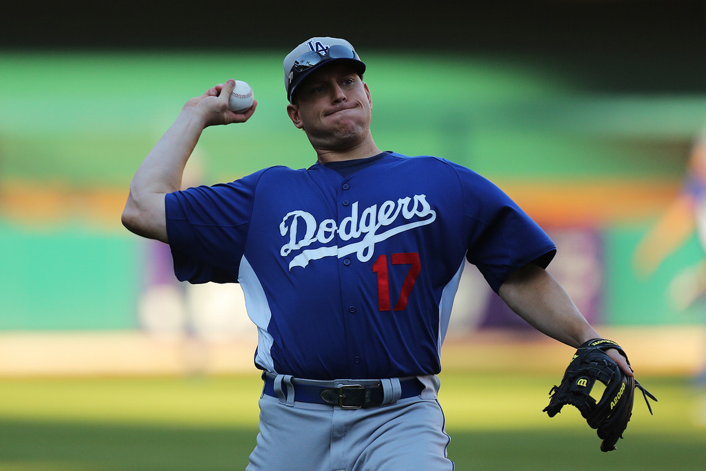 . ST LOUIS, MO - OCTOBER 11:  A.J. Ellis #17 of the Los Angeles Dodgers thows during batting practice prior to Game One of the National League Championship Series against the St. Louis Cardinals at Busch Stadium on October 11, 2013 in St Louis, Missouri.  (Photo by Ed Zurga/Getty Images)