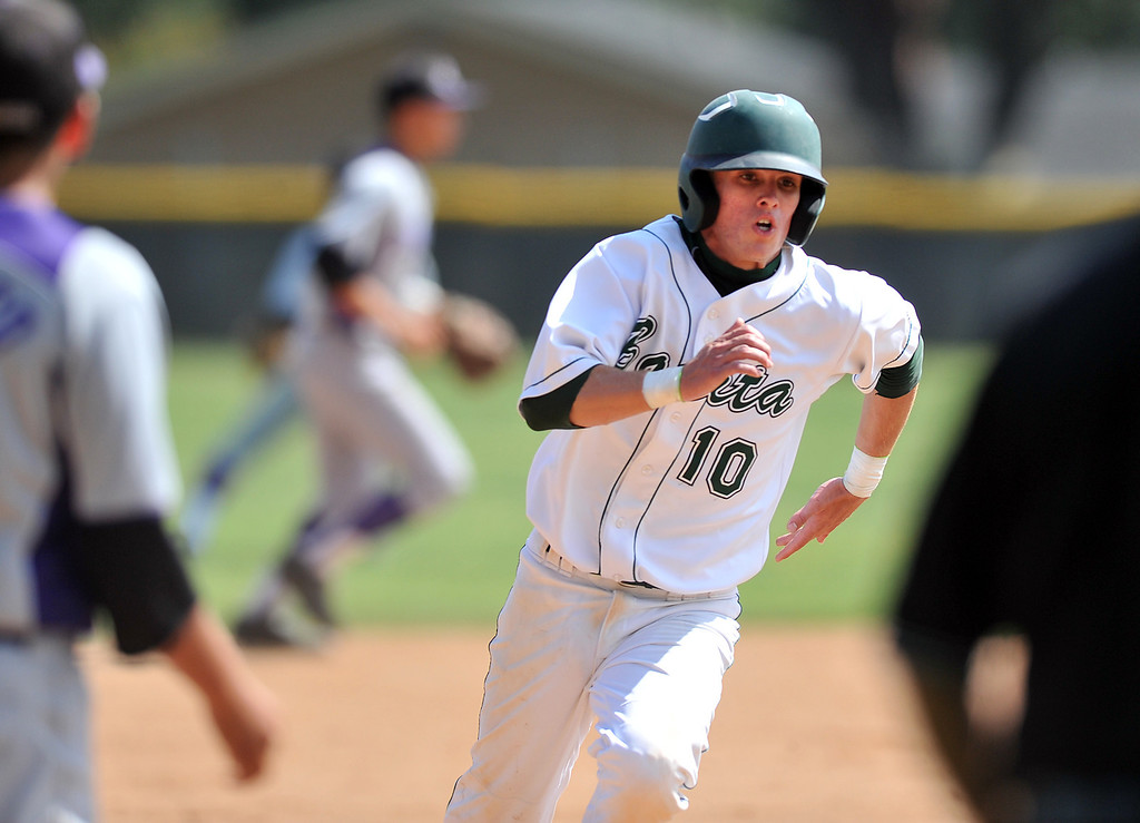 . Bonita\'s Justin Row (#10) rounds third base as they play Cathedral in their CIF playoff game at Bonita High School in La Verne on Thursday May 16, 2013. Cathedral beat Bonita 3-1. (SGVN/Staff Photo by Keith Durflinger)