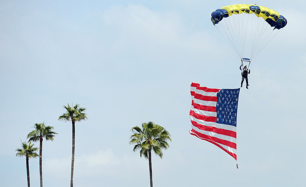 . A US Navy parachutist lands on the field during the Dodgers home opener at Dodger Stadium Friday 4, 2014.  (Photo by Hans Gutknecht/Los Angeles Daily News)
