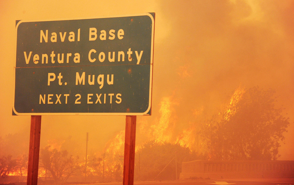 . Fire burns along the Pacific Coast Highway close to Naval Base Ventura County (NBVC) near Point Mugu, California May 3, 2013. Some 4,000 homes were threatened by a growing wildfire northwest of Los Angeles that has forced the closure of California\'s scenic coastal highway, firefighters said Friday.   (ROBYN BECK/AFP/Getty Images)