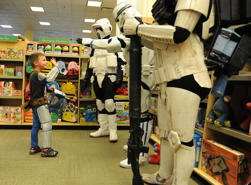 . (John Valenzuela/Staff Photographer) Enzo Rivera 4, of Redlands waves to meembers of the 501st Stormtroopers at Barnes & Noble Bookstore in Redlands during the Star Wars Reads Day, Saturday, Oct. 5, 2013.