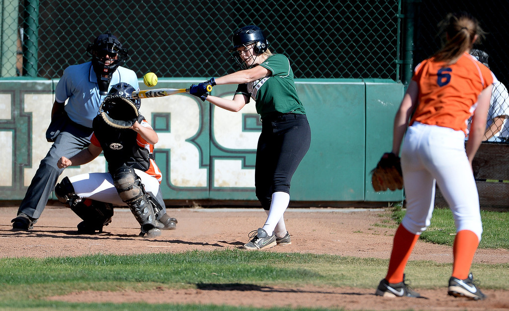 . Westridge\'s Mia Mayberry hits against Poly in the fourth inning of a prep softball game at Westridge High School in Pasadena, Ca on Tuesday, April 15, 2014. Poly won 11-1. (Keith Birmingham Pasadena Star-News)