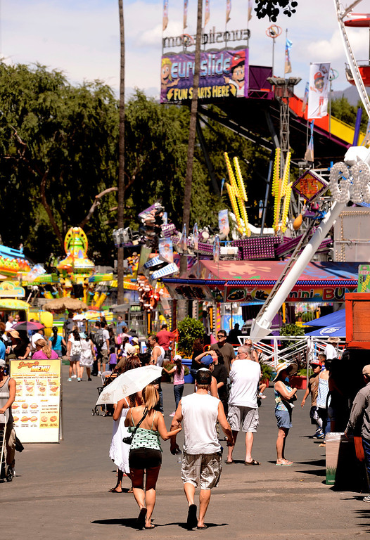 . Crowds flock the midway during Labor Day weekend of the 91st Annual Los Angeles County Fair in Pomona September 1, 2013. GABRIEL LUIS ACOSTA/STAFF PHOTOGRAPHER.