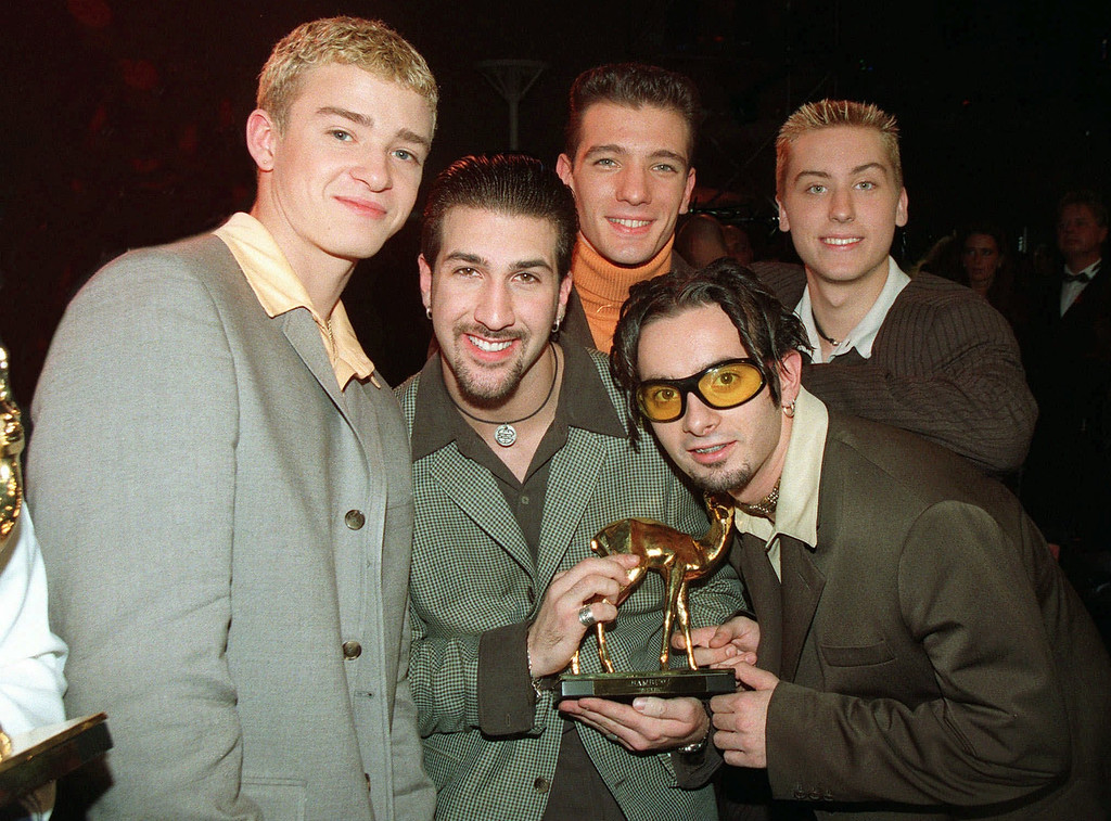 ". Members of the U.S. band N*SYNC, left to right, Lance, JC, Joey, Cris and Justin, pose for the photographers after being awarded with the ""Bambi\"" statuette, a German media prize, in Cologne Saturday night, October 25, 1997. (AP PHOTO/Fritz Reiss)"
