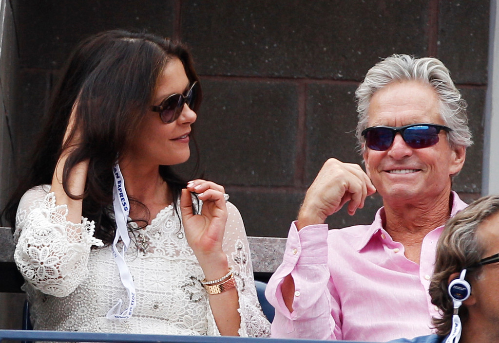 . Catherine Zeta-Jones and Michael Douglas watch Novak Djokovic of Serbia play Roger Federer of Switzerland during a semifinal match at the U.S. Open tennis tournament in New York, Saturday, Sept. 10, 2011. (AP Photo/Charles Krupa)