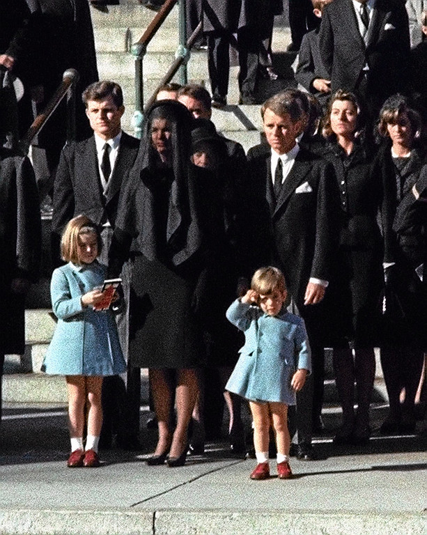 . Three-year-old John F. Kennedy Jr. salutes his father\'s casket in Washington in this Nov. 25, 1963 file photo, three days after the president was assassinated in Dallas. Widow Jacqueline Kennedy, center, and daughter Caroline Kennedy are accompanied by the late president\'s brothers Sen. Edward Kennedy, left, and Attorney General Robert Kennedy. (AP Photo/FILE)