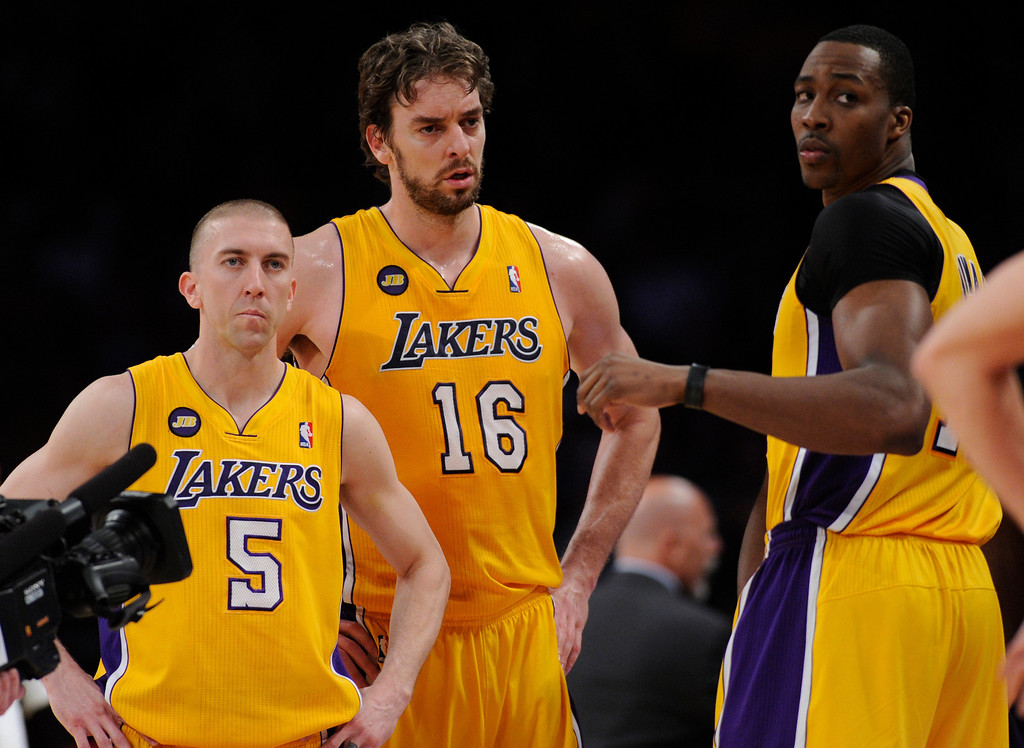 . Lakers#5 Steve Blake, Pau Gasol and Dwight Howard look to the floor after an official time-out in the first half. The Lakers faced the Houston Rockets in the final home game of the year at Staples Center in Los Angeles, CA 4/17/2013 (John McCoy/Los Angeles Daily News)