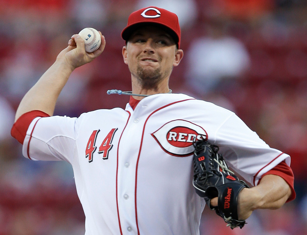 . Cincinnati Reds starting pitcher Mike Leake throws to a Los Angeles Dodgers batter in the first inning of a baseball game, Friday, Sept. 6, 2013, in Cincinnati. (AP Photo/Al Behrman)