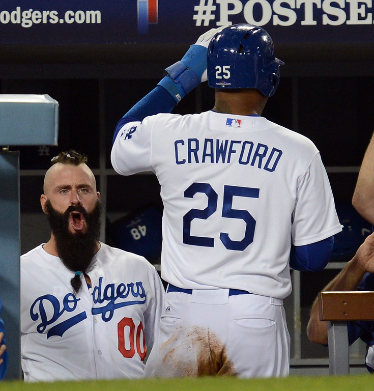 . The Dodgers\' Brian Wilson reacts as Carl Crawford enters the dugout after scoring in the 8th inning during game 3 of the NLCS against the Cardinals at Dodger Stadium Monday, October 14, 2013. (Photo by Hans Gutknecht/Los Angeles Daily News)