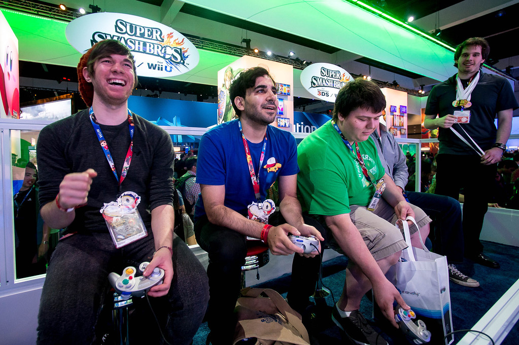 """. Attendees play the Nintendo \""""Super Smash Bros\"""" video game at at the Electronic Entertainment Expo in Los Angeles on Tuesday, June 10, 2014. (Photo by Watchara Phomicinda)"""