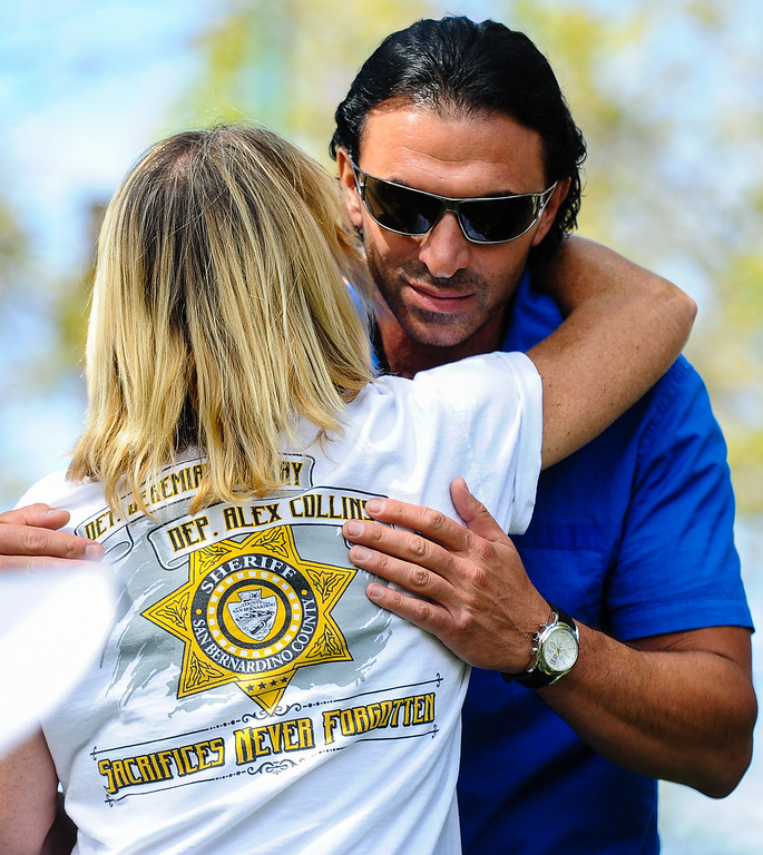 . Sculptor Khachik Khachatouryan (cq) receives a hug from Dawn MacKay, mother of slain San Bernardino Sheriff\'s Deputy Jeremiah MacKay, after the unveiling of the Jeremiah MacKay bronze statue in front of friends, family and the public at the Lake Arrowhead Village in Lake Arrowhead on Sunday, Sept. 1, 2013. San Bernardino County Sheriff\'s Detective MacKay was killed on Feb. 12 in a gun battle with fugitive ex-cop Christopher Dorner near Big Bear during a massive manhunt in search of Dorner. (Rachel Luna / Staff Photographer)