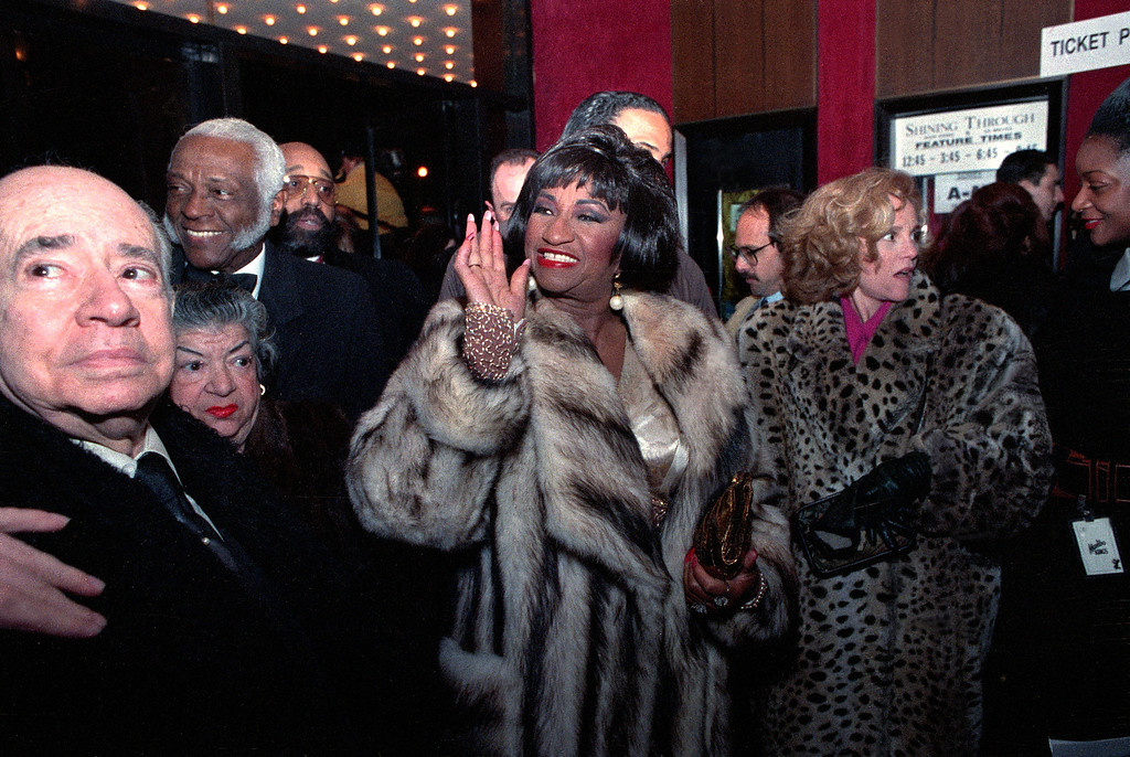 ". Singer and actress Celia Cruz arrives for the screening of ""The Mambo Kings\"" at the Ziegfeld Theatre in New York City on Feb. 12, 1992. (AP Photo/Bebeto Matthews)"