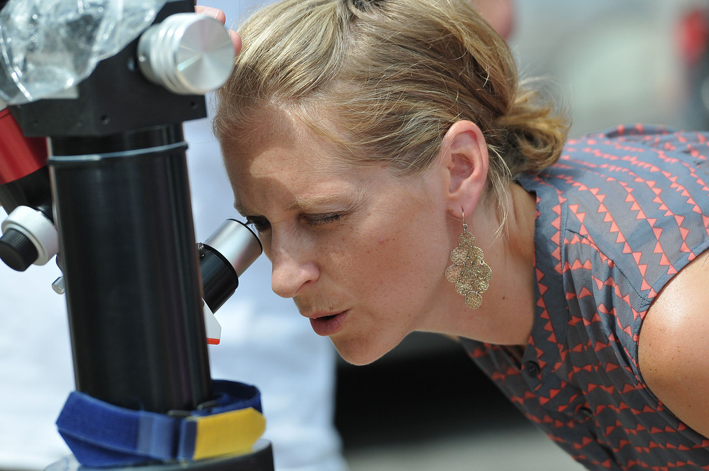 . (John Valenzuela/Staff Photographer) Jennifer Chance, of Rancho Cucamonga, looks through a telescope at the sun, outside the A.K. Smiley Library in Redlands Thursday, August 29, 2013. Jim Sommer, a member of the San Bernardino Valley Amateur Astronomers brought his Lunt 60MM Solar Telescope to the Smiley Library to let people �safely� view the sun.