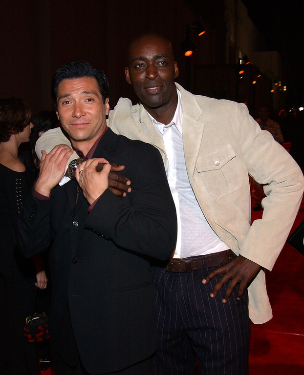 """. Actor Benito Martinez and actor Michael Jace attend the premiere of the TV series \""""The Shield\"""" March 11, 2002 in Los Angeles, CA. (Photo by Sebastian Artz/Getty Images)"""