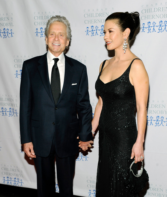 ". Actor Michael Douglas and wife actress Catherine Zeta-Jones attend the ""Children At Hope\"" gala dinner at Pier Sixty on Monday, Nov. 21, 2011 in New York. (AP Photo/Evan Agostini)"
