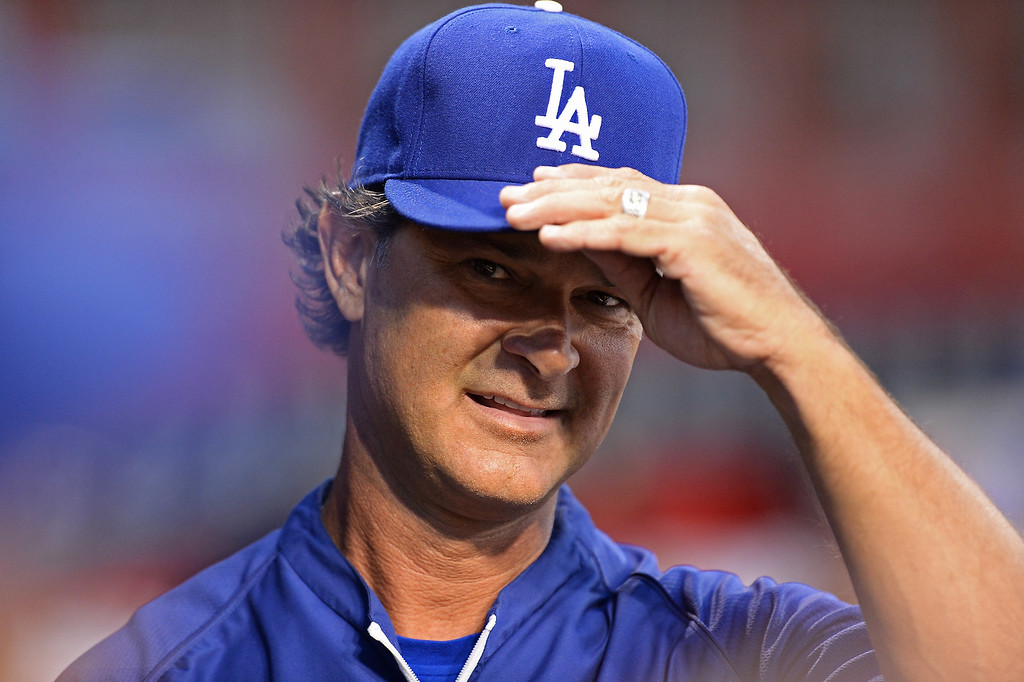 . CINCINNATI, OH - SEPTEMBER 8:  Manager Don Mattingly #8 of the Los Angeles Dodgers watches his team play against the Cincinnati Reds in the first inning at Great American Ball Park on September 8, 2013 in Cincinnati, Ohio. Cincinnati defeated Los Angeles 3-2 to sweep the series.  (Photo by Jamie Sabau/Getty Images)