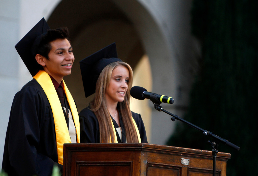 . Citrus Valley High School\'s Adrian Puentes, left, and Shelby Pearce speak during their graduation ceremony on Wednesday, June 11, 2014 at the Redlands Bowl in Redlands, Ca.  (Photo by Micah Escamilla/Redlands Daily Facts)