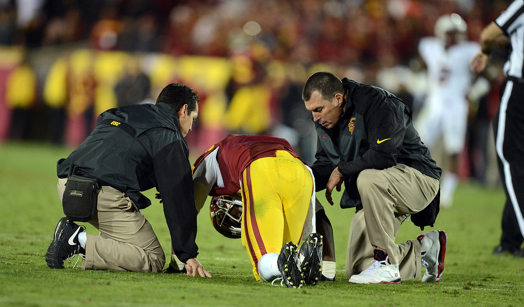 . USC�s Marqise Lee #9 is looked at after being hurt during their game against Stanford at the Los Angeles Memorial Coliseum Saturday, November 16, 2013. USC beat Stanford 20-17. (Photos by Hans Gutknecht/Los Angeles Daily News)